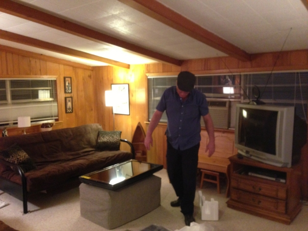 Keith getting ready to install the TV in the den